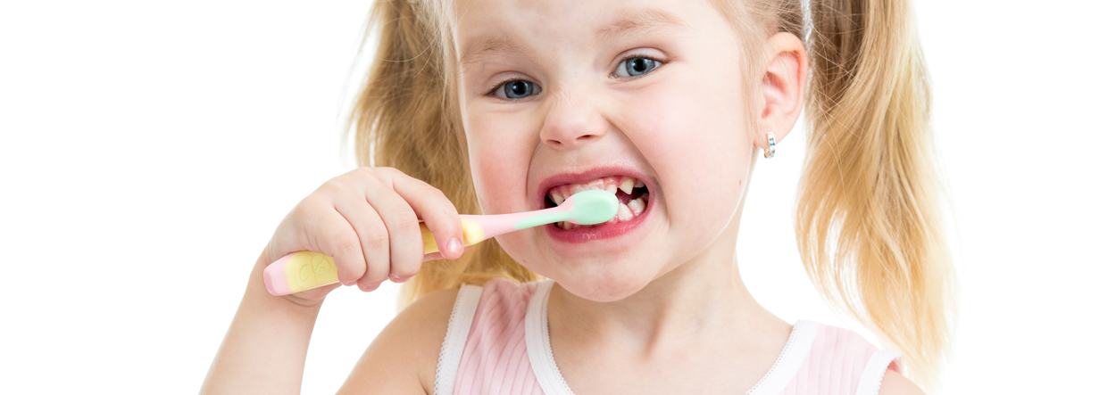 child girl brushing teeth isolated on white